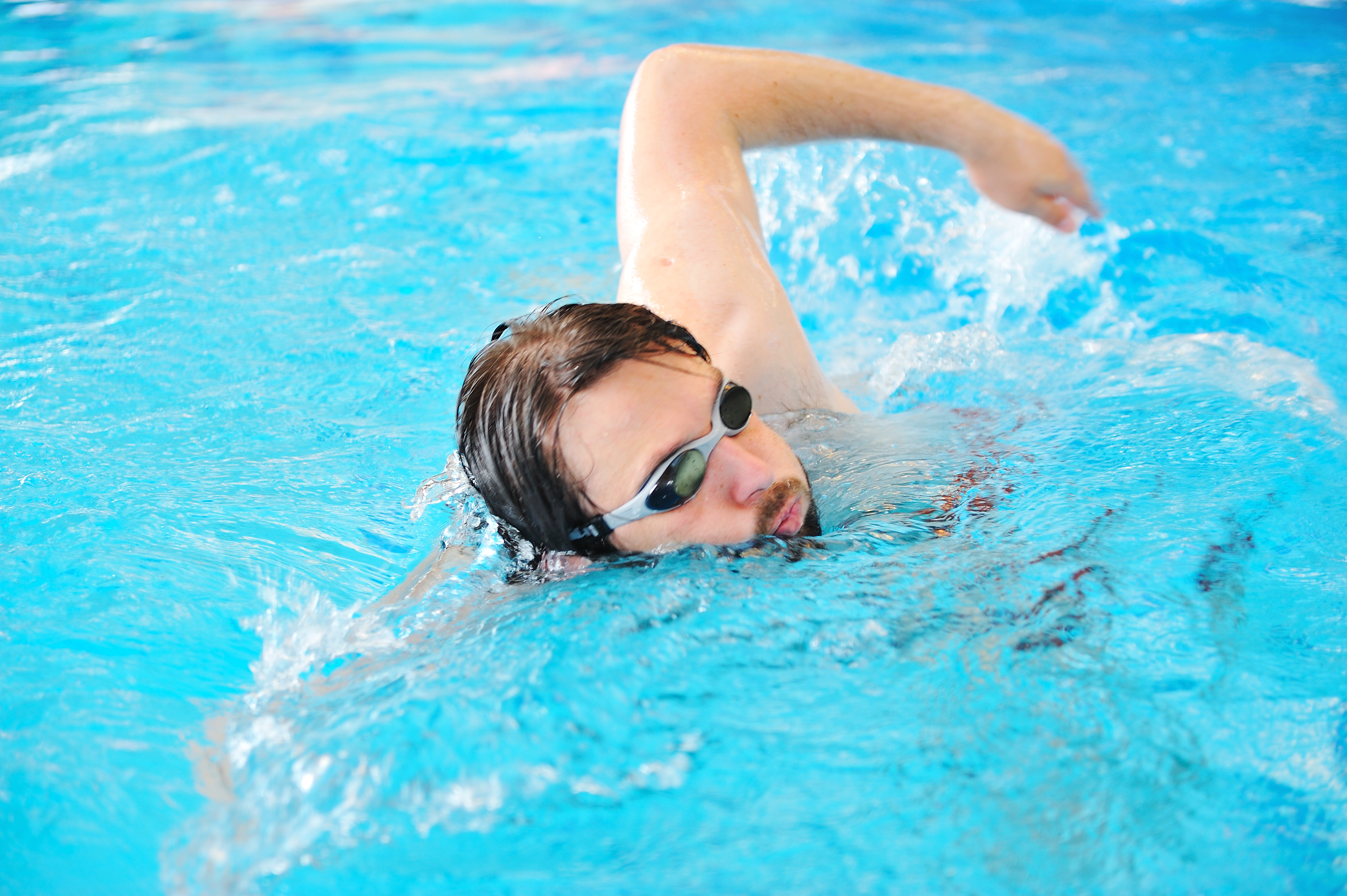 It is possible to burn around 300 calories per half hour once you can work your way up to a moderate pace. If you are a beginner, you will likely burn more calories at first because it takes a lot more effort for you to move through the water. That can be a big boon if your primary goal is weight loss. Still, more experienced swimmers can still get in a great cardio workout for the entire body. https://www.storyblocks.com/stock-image/swimmer-excercise-on-indoor-swimming-pool-sport-and-health-concept-soluowcphzj8iow8i8 Benefits of Swimming for Strength Training If you've ever watched the Olympics, you may have sat in awe gazing at the bodies of Olympic-level swimmers. While you may not aspire to stand on the podium one day, one of the significant benefits of swimming every day is how it can sculpt and shape your muscles. Your shoulders and back are often the most prominent beneficiaries along with your glutes and quads. The type of stroke you use makes a difference in which muscles get the biggest workout. Here is a rundown of which muscles gain the most based on the stroke being used. Backstroke Trapezoids Glutes Quads Middle and upper back Freestyle Chest Biceps Triceps Quads Forearms Neck Middle and upper back Breaststroke Back of shoulders Quads Calves Chest Butterfly Neck Abs Chest Shoulders Upper and lower back Lateral hamstring Quads Calves Dive In Today Aim for 30 minutes at a time when swimming, though it is okay if you can't go that long at first. Make sure to warm yourself up properly and rest as needed to avoid cramps and overextending yourself. Are you interested in having a pool installed? Ready to start swimming and reap the health benefits? Call Aqua Spas and Pools today at (877) 775-3442 or via our contact form.